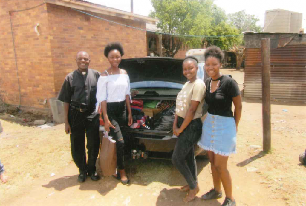 Father Joseph with 3 youths arrived at Dominionville Orphanage with toys and clothing for orphans